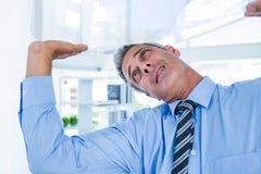 A serious businessman lifting something Stock Photos