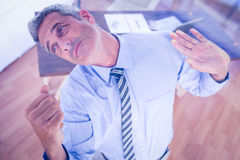 A serious businessman lifting something Royalty Free Stock Image
