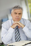 Serious businessman listening Stock Images