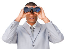 Serious businessman looking through binoculars Royalty Free Stock Images