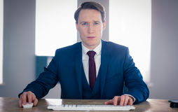 Serious businessman looking at camera Royalty Free Stock Images