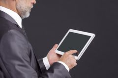 Serious businessman looking at digital tablet screen.  stock image