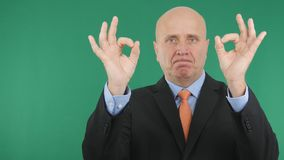 Serious Businessman Make Double Ok Hand Sign a Good Job Gestures. royalty free stock images