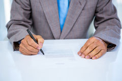 Serious businessman making notes Royalty Free Stock Images