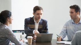 Serious businessman making online business project presentation at group negotiations. Male manager speaking at team briefing analyzing data report plan work stock photos