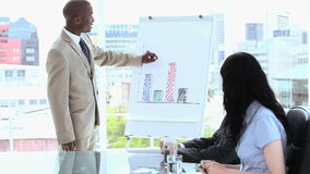 Serious businessman making a presentation Stock Photo