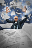 Serious businessman manipulating papers. Against dramatic blue sky Royalty Free Stock Photos