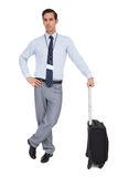 Serious businessman next to his suitcase Royalty Free Stock Photography