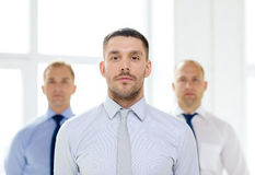 Serious businessman in office with team on back Royalty Free Stock Photography