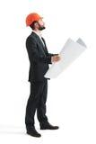 Serious businessman in orange hardhat Royalty Free Stock Photo