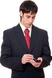Serious businessman with palmtop. Portrait of serious businessman with palmtop Stock Photos