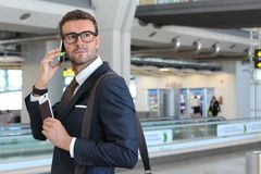 Serious businessman during a phone call at the airport.  Stock Photography