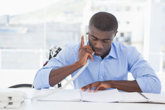 Serious businessman on the phone at desk Royalty Free Stock Images