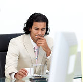 Serious businessman playing with kinetic balls Royalty Free Stock Images
