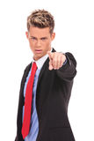 Serious businessman pointing accusing finger Royalty Free Stock Photo