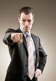 Serious businessman pointing accusing finger Royalty Free Stock Photos