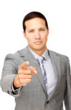 Serious businessman pointing at the camera Royalty Free Stock Images