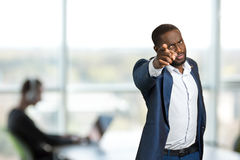 Serious businessman pointing forward. royalty free stock photos