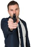 Serious businessman pointing a gun Royalty Free Stock Photography