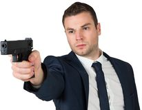 Serious businessman pointing a gun Stock Photo