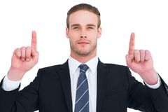 Serious businessman pointing up his fingers Royalty Free Stock Photos
