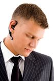 Serious businessman posing with bluetooth Stock Photo