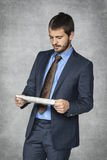 Serious businessman reading  newspapers Royalty Free Stock Photography