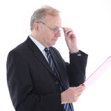 Serious businessman reading report Stock Image