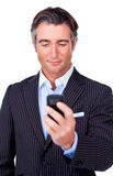 Serious businessman sending a text Stock Photo