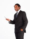 Serious businessman sending text message Stock Photos