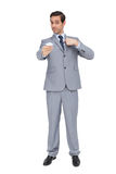 Serious businessman showing his business card Royalty Free Stock Photography