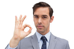 Serious businessman showing ok sign Royalty Free Stock Photo