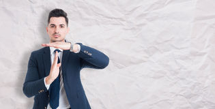 Serious businessman showing time out sign Royalty Free Stock Photo