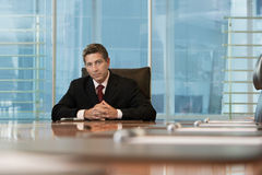 Serious Businessman Sitting At Conference Table Stock Photos