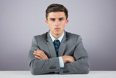 Serious businessman sitting at desk Stock Images