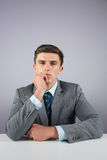 Serious businessman sitting at desk Royalty Free Stock Images