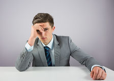 Serious businessman sitting at desk Stock Image