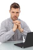 Serious businessman sitting at desk Royalty Free Stock Photo