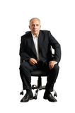 Serious businessman sitting on office chair Stock Photography