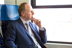 Serious businessman sitting in a train Royalty Free Stock Images