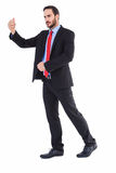 Serious businessman standing with arms raised Royalty Free Stock Images
