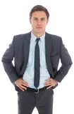 Serious businessman standing with hands on hips Stock Photo