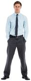 Serious businessman standing with hands in pockets Stock Images
