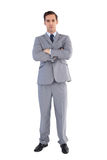Serious businessman standing with his arms crossed Stock Photos