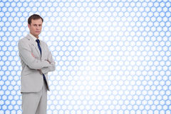 Serious businessman standing with his arms folded Royalty Free Stock Photo