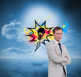 Serious businessman standing with his arms folded Royalty Free Stock Photos