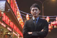 Serious Businessman standing on the street, red lanterns in the background Stock Photography