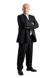 Serious businessman standing in the studio Royalty Free Stock Photos