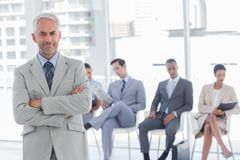 Serious businessman standing in a waiting room Royalty Free Stock Images