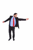 Serious businessman in suit gesturing with hand Royalty Free Stock Images